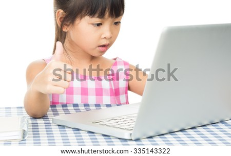 Portrait of a young girl working on laptop,on the white background. - stock photo