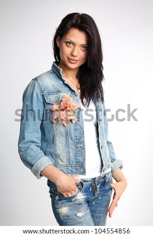 Portrait of a young gorgeous woman in denim - stock photo
