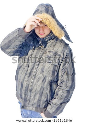 Portrait of a young guy in a jacket on a white background - stock photo