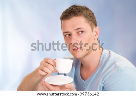 portrait of a young guy with cup