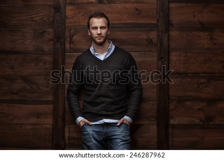 Portrait of a young handsome man fashion model in urban background