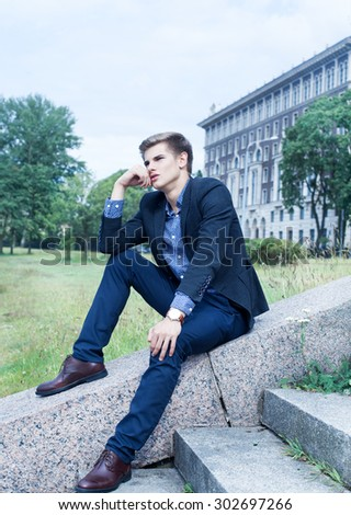 Portrait of a young handsome man outdoors  - stock photo