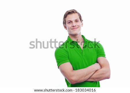 Portrait of a young handsome man wearing green t-short isolated on white background - stock photo
