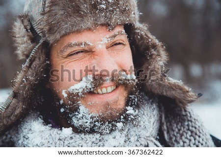 Portrait of a young handsome man with a beard. A person close-up of a bearded man. Face full face bearded. A man with a beard winter.