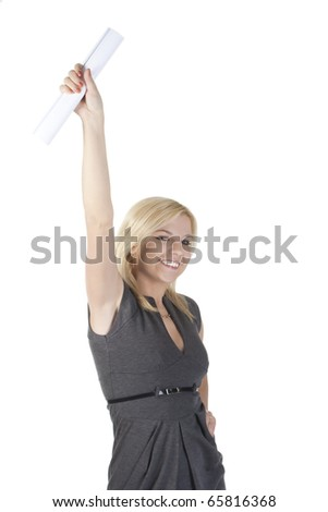 Portrait of a young happy attractive woman holding folded paper up - stock photo