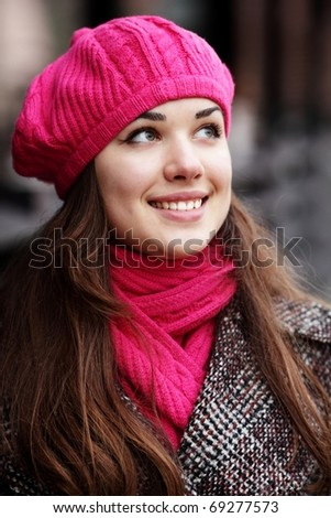 Portrait of a young happy beautiful lady in autumn cloths outdoors - stock photo