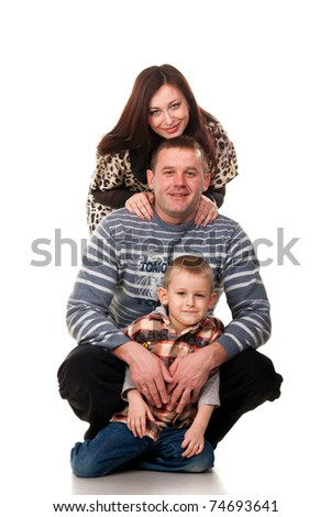 Portrait of a young happy smiling family isolated on white - stock photo