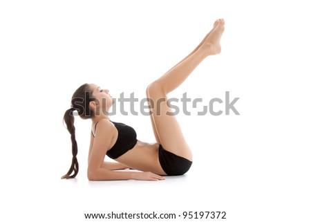 Portrait of a young healthy woman fitness abdominal exercises over white background, - stock photo
