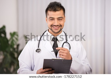 portrait of a young Indian doctor - stock photo