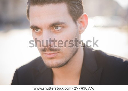 Portrait of a young italian boy posing through the street of the city