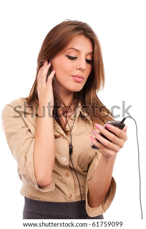 Portrait of a young lady with earphones listening music to her modern cellphone or handset