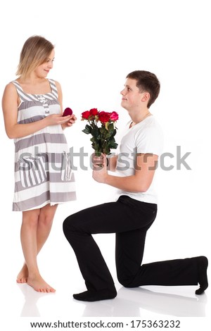 portrait of a young loving couple with a bouquet of red roses. - stock photo
