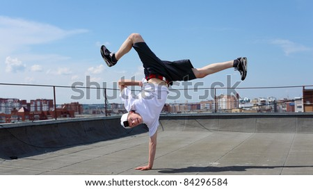 portrait of a young male street dancer outdoors - stock photo