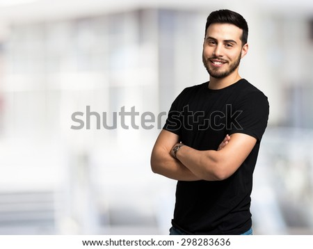 Portrait of a young man against a bright background - stock photo