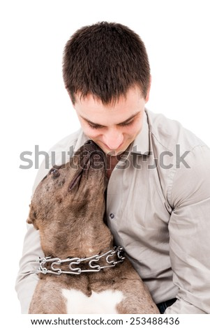 Portrait of a young man and a pit bull isolated on white background - stock photo