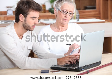 portrait of a young man and older woman - stock photo