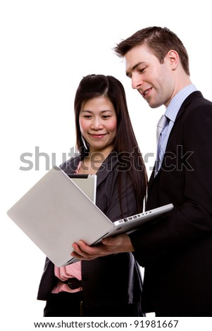 Portrait of a young man and woman business team with computer against white background