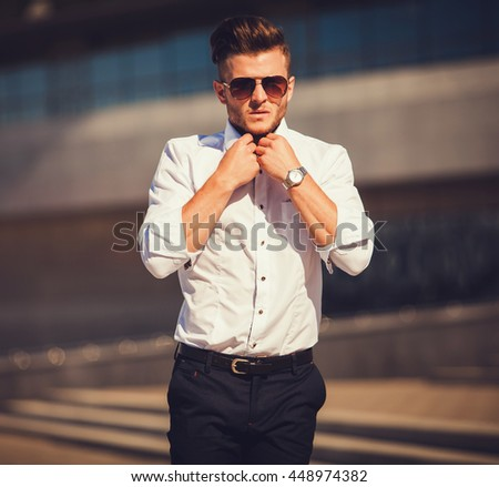 Portrait of a young man in a shirt and glasses aviators - stock photo
