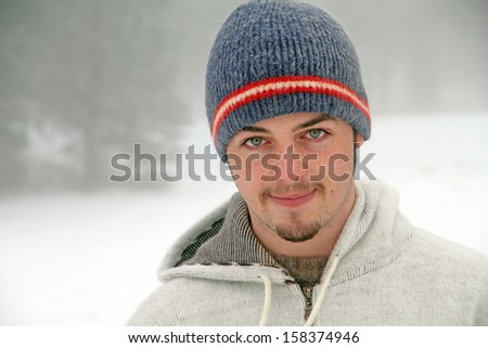 Portrait of a young man in a snowing mountain Spain - stock photo