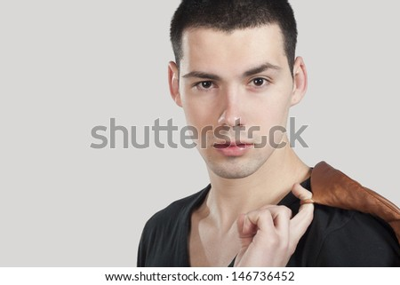 portrait of a young man isolated on gray background - stock photo