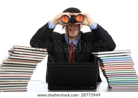 Portrait of a young man looking through a binocular. Theme: education career, success. - stock photo