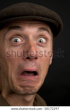 Portrait of a young man making faces. - stock photo