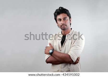 Portrait of a young man of Indian origin - stock photo