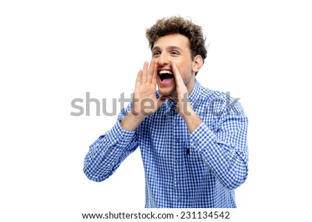 Portrait of a young man shouting loud with hands on the mouth - stock photo