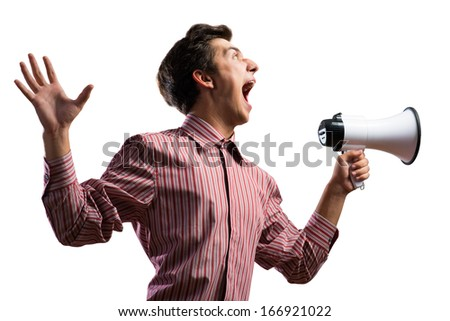 Portrait of a young man shouting using megaphone, isolated on white background - stock photo