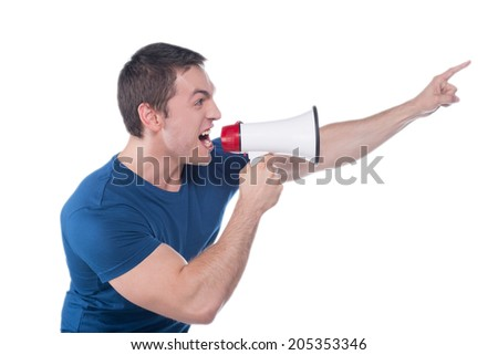 Portrait of a young man shouting with megaphone