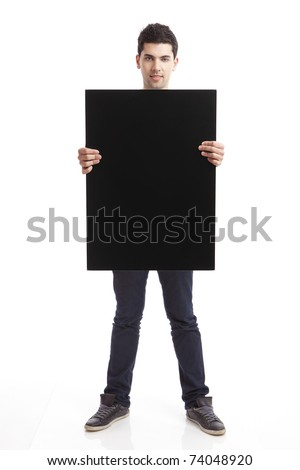 Portrait of a young man showing an empty black billboard on white background