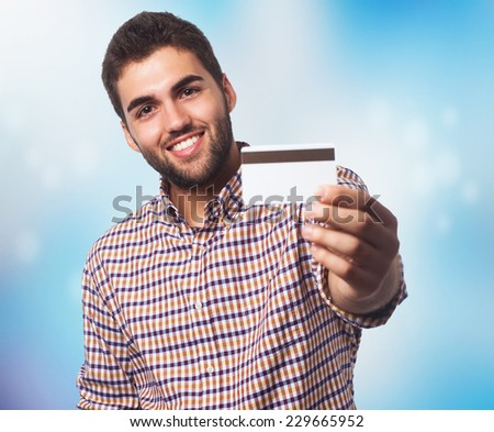 portrait of a young man showing his credit card