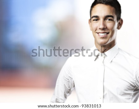 portrait of a young man smiling in a house - stock photo