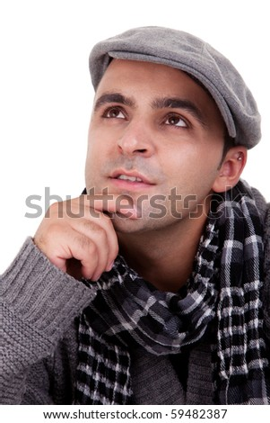 Portrait of a young man thinking, in autumn/winter clothes, isolated on white. Studio shot - stock photo