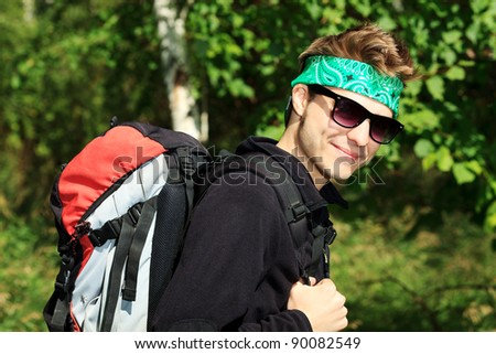 Portrait of a young man tourist posing outdoor. - stock photo