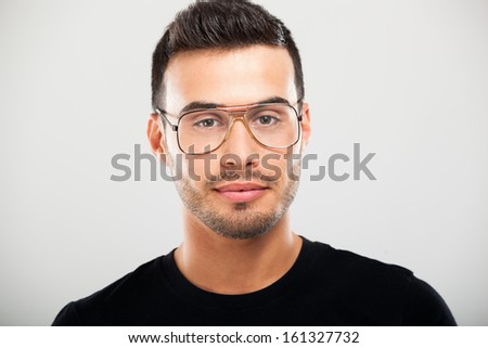 Portrait of a young man wearing eyeglasses - stock photo