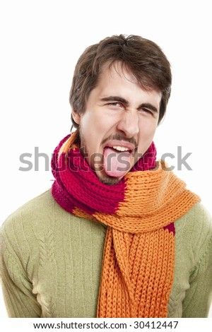 Portrait of a young man wearing scarf and green pullover against white background - stock photo