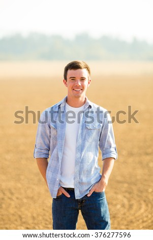 Portrait of a young man who is a high school senior in Oregon. - stock photo