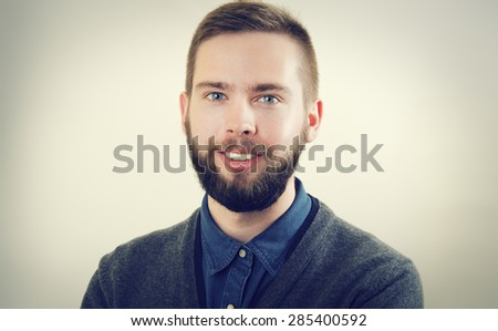 Portrait of a young man with a beard - stock photo