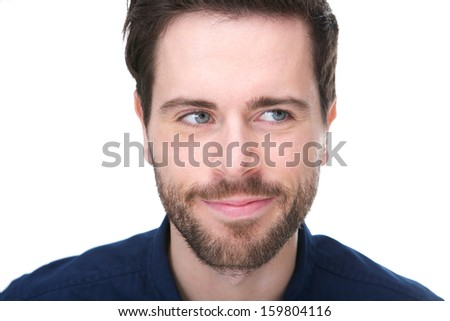 Portrait of a young man with a grin and looking away - stock photo