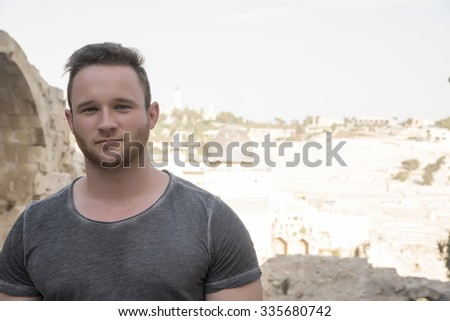 Portrait of a young man with Al-Aqsa background - stock photo