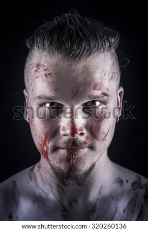 portrait of a young man with blood - stock photo