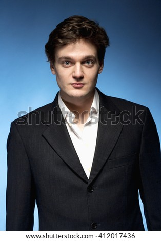 Portrait of a Young Man with Brown Hair in Suit. - stock photo