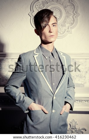 Portrait of a young man with fashionable hairstyle. Avant-garde hairstyles. - stock photo