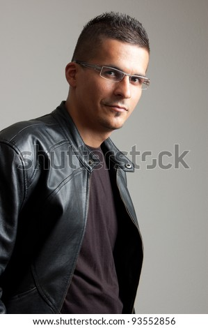 portrait of a young man with glasses - stock photo