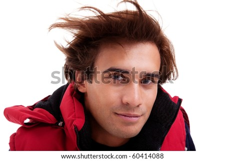 Portrait of a young man with hair on the wind , in autumn/winter clothes, isolated on white. Studio shot - stock photo