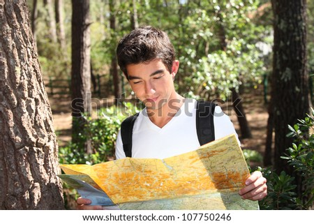 portrait of a young man with map - stock photo