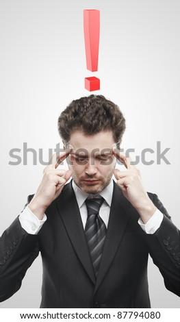 Portrait of a young man with red exclamation mark above his head. Conceptual image of a open minded man. On a gray background - stock photo