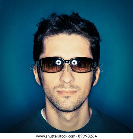 Portrait of a young man with sunglasses. - stock photo