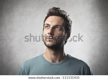 Portrait of a young man with thoughtful expression